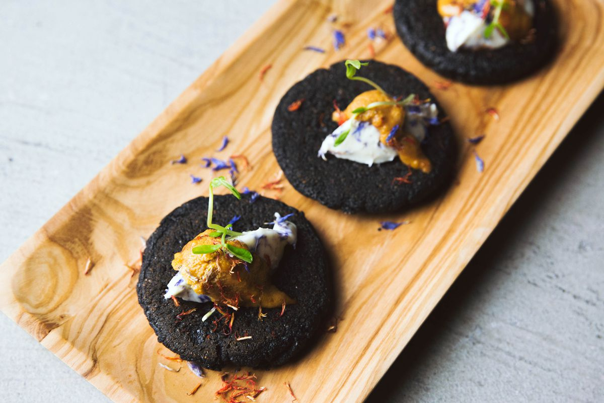 Squid ink arepitas with cultured butter and sea urchin roe from Serenata
