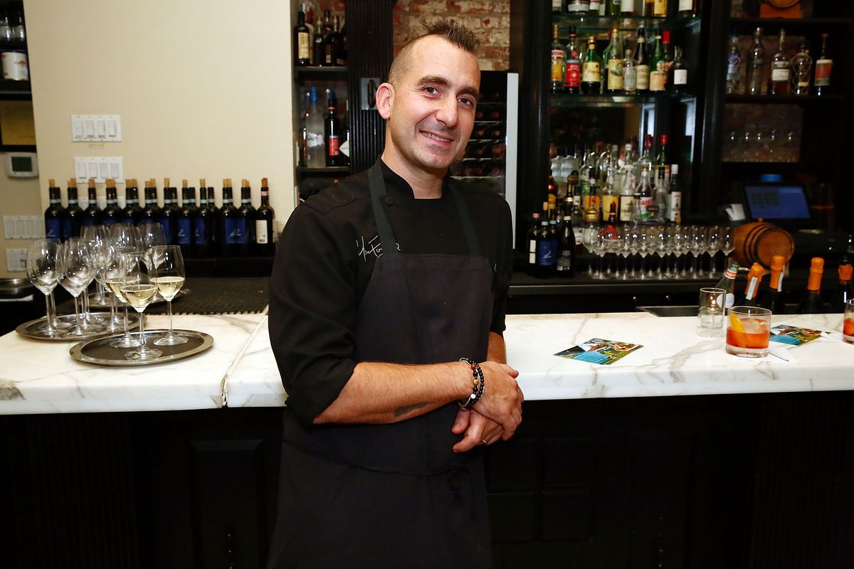 Marc Forgione standing next to a marble bar