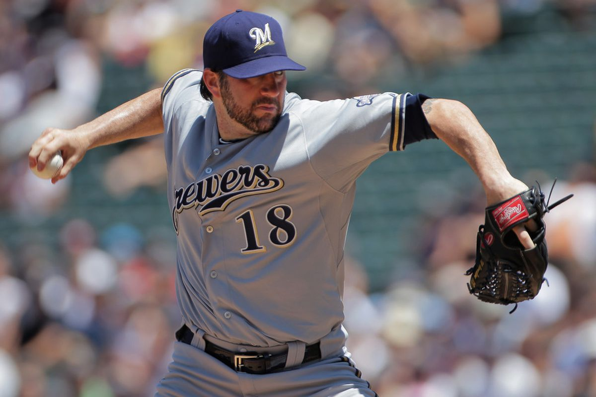 DENVER, CO - JULY 17:  Starting pitcher Shaun Marcum #18 of the Milwaukee Brewers delivers against the Milwaukee Brewers at Coors Field on July 17, 2011 in Denver, Colorado.  (Photo by Doug Pensinger/Getty Images)