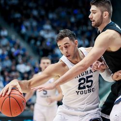 Brigham Young Cougars forward Gavin Baxter (25) drives against Gonzaga Bulldogs forward Killian Tillie (33) at the Marriott Center in Provo on Saturday, Feb. 22, 2020.