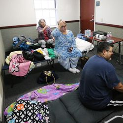 Hassan and Mary Mohammed, and Mary's mother, Mary Tucker, stay in a classroom in an LDS Church stake center during Tropical Storm Harvey in Houston on Tuesday, Aug. 29, 2017.