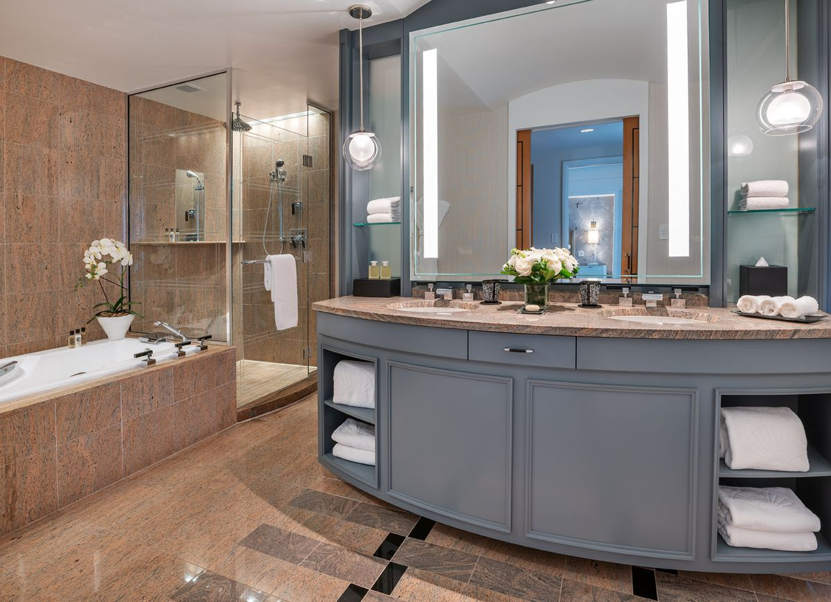 Rendering of a spacious bathroom with a large counter and a tub.