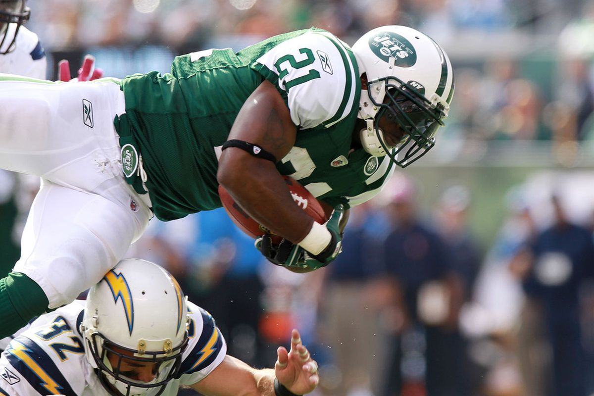 EAST RUTHERFORD, NJ - OCTOBER 23: LaDainian Tomlinson #21 of the New York Jets is tackled by Eric Weddle #32 of the San Diego Chargers at MetLife Stadium on October 23, 2011 in East Rutherford, New Jersey.  (Photo by Nick Laham/Getty Images)