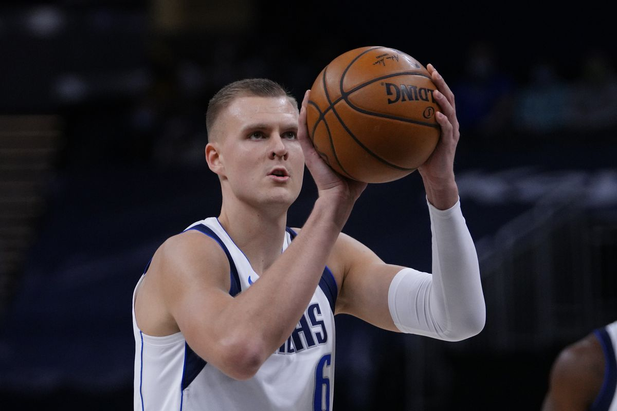 Kristaps Porzingis of the Dallas Mavericks shoots a free throw during the game against the Indiana Pacers on January 20, 2021 at Bankers Life Fieldhouse in Indianapolis, Indiana.