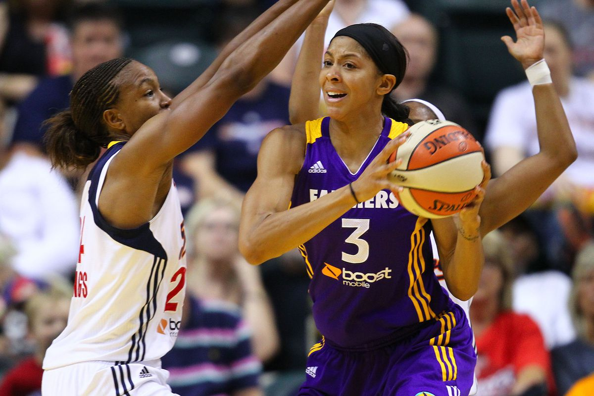July 12, 2012; Indianapolis, IN, USA; Los Angeles Sparks forward Candace Parker (3) looks to pass off the ball as Indiana Fever forward Tamika Catchings (24) guards at Bankers Life Fieldhouse. <em>Photo by Michael Hickey-US PRESSWIRE.</em>