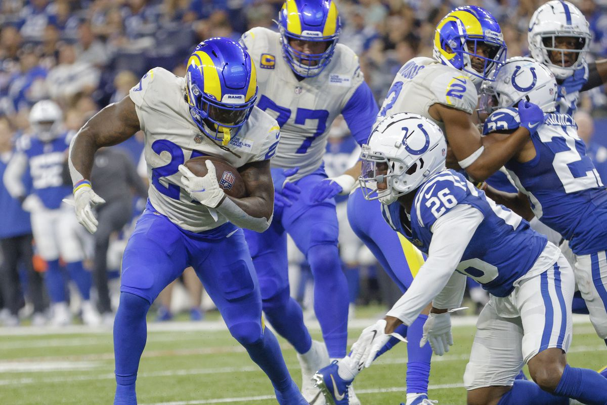 Darrell Henderson #27 of the Los Angeles Rams runs the ball as Rock Ya-Sin #26 of the Indianapolis Colts misses the tackle at Lucas Oil Stadium on September 19, 2021 in Indianapolis, Indiana.