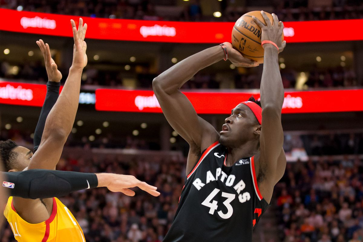 Toronto Raptors forward Pascal Siakam shoots the ball against Utah Jazz guard Donovan Mitchell during the first half at Vivint Smart Home Arena.