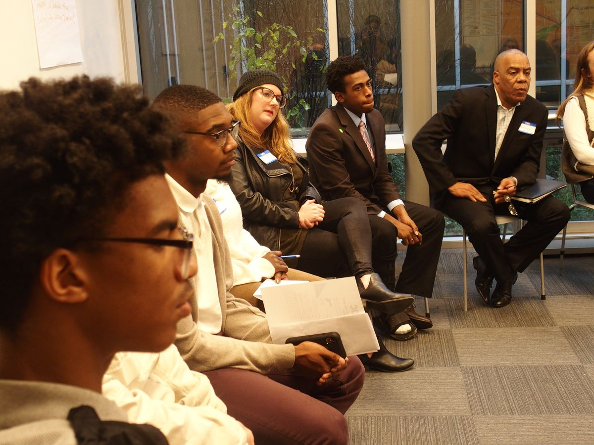 Students and community members listen during a small group discussion at BRIDGES' Youth Action Networking Day on Dec. 15.