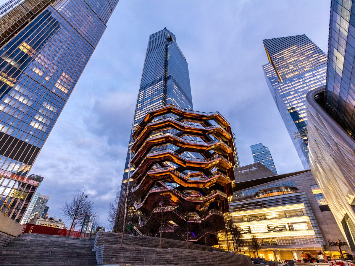 Multiple tall skyscrapers and a structure called The Vessel.