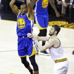 Golden State Warriors forward Andre Iguodala (9) passes as Cleveland Cavaliers forward Kevin Love (0) defends during the first half of Game 4 of basketball's NBA Finals in Cleveland, Friday, June 9, 2017. (AP Photo/Tony Dejak)