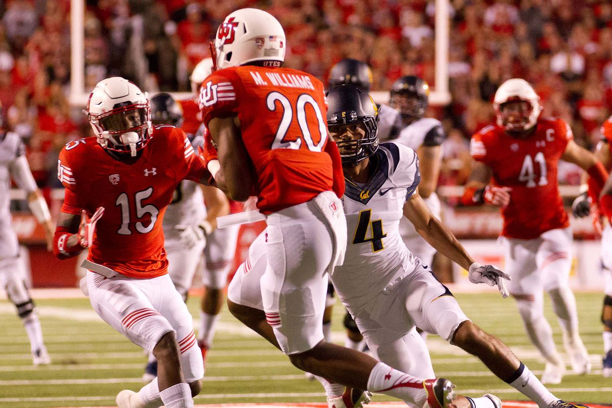 Oct 10, 2015; Salt Lake City, UT, USA; Utah Utes defensive back Marcus Williams (20) intercepts a pass intended for California Golden Bears wide receiver Kenny Lawler (4) during the first quarter at Rice-Eccles Stadium.