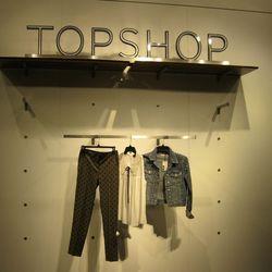 Polka-dot trousers, $76. Sheer white sleeveless blouse, $64. Studded denim moto jacket, $120.