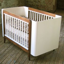 """Case Kids' modern <a href=""""http://www.casakids.com/ola_crib.html"""">crib</a>  ($1100) was made in Brooklyn and converts to a toddler bed."""