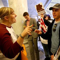 Kim Henderson, who is opposed to a potential Bears Ears national monument, talks to Courtney McBride, who supports a potential Bears Ears national monument, at the Capitol in Salt Lake City on Monday, Dec. 19, 2016. President Barack Obama declared a Bears Ears National Monument for Utah on Wednesday, Dec. 28, 2016.