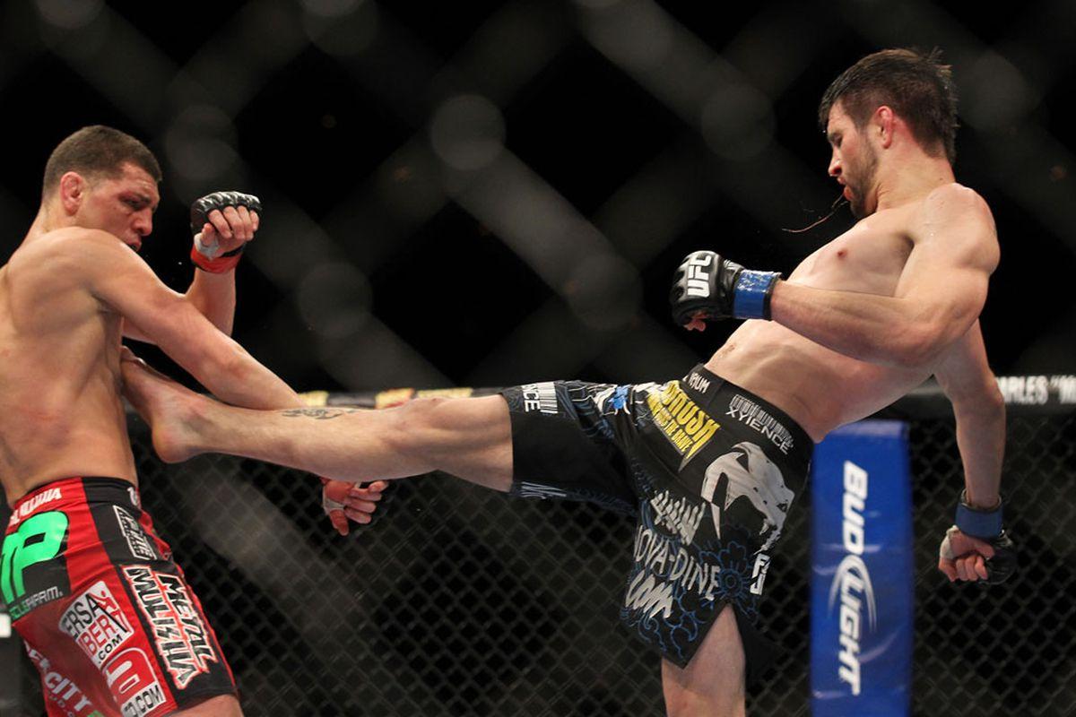 LAS VEGAS - FEBRUARY 04: (R-L) Carlos Condit kicks Nick Diaz during the UFC 143 event at Mandalay Bay Events Center on February 4, 2012 in Las Vegas, Nevada. (Photo by Josh Hedges/Zuffa LLC/Zuffa LLC via Getty Images)