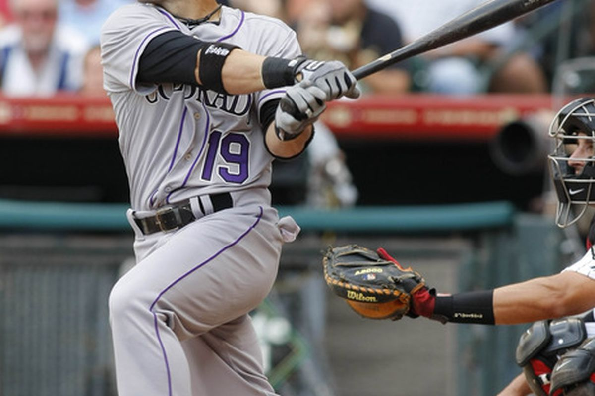 Apr 6, 2012; Houston, TX, USA; Colorado Rockies second baseman Marco Scutaro (19) bats against the Houston Astros in the first inning at Minute Maid Park on Opening Day. Mandatory Credit: Brett Davis-US PRESSWIRE