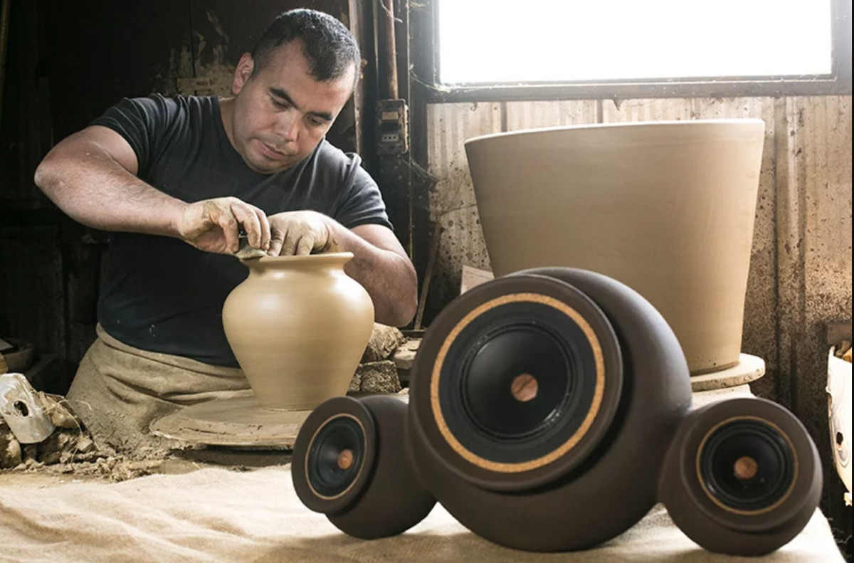 Person throwing clay pots