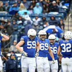 BYU's offensive line competes in the Blue-White game at LaVell Edwards Stadium in Provo on Saturday, April 7, 2018.