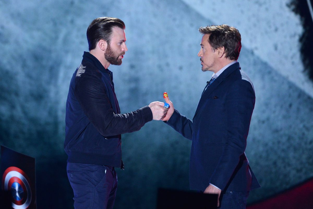 Actors Chris Evans (L) and Robert Downey Jr. speak onstage during Nickelodeon's 2016 Kids' Choice Awards at the Forum on March 12, 2016, in Inglewood, California.