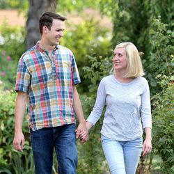 Newlyweds Jason, 27, and Emily Brand, 26, hold hands outside their new home July 20, 2015, in Holladay. A new study from University of Utah professor Nicholas Wolfinger shows that those who tie the knot after their early 30s are now more likely to divorce than those who marry in their late 20s.