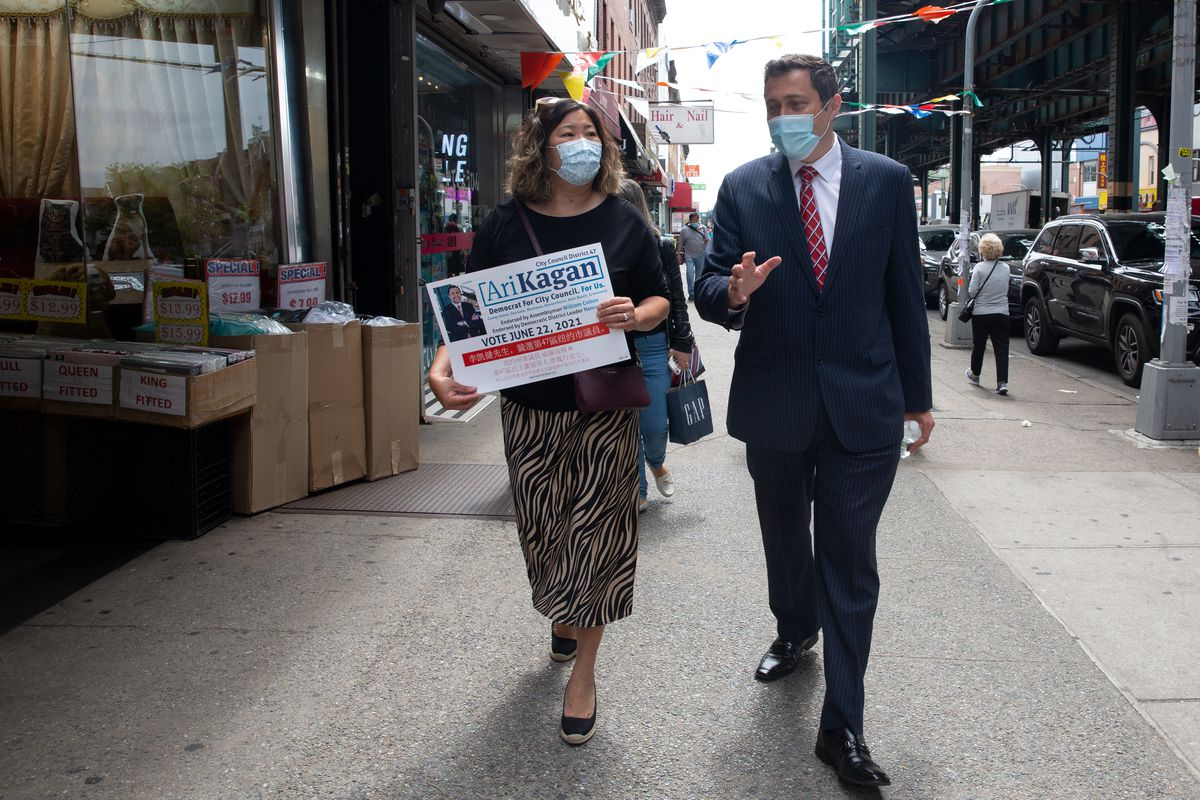 City Council candidate Ari Kagan gives Rep. Grace Meng a tour of businesses along 86th Street in Brooklyn, May 24, 2021.