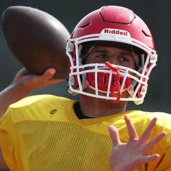 Marist's Mike Markett throws a pass. Allen Cunningham/For the Sun-Times.