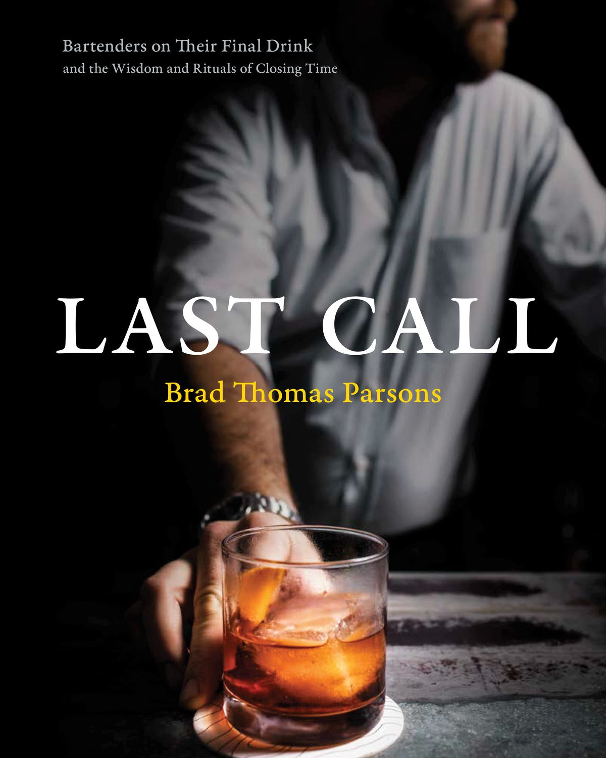 """The book cover for """"Last Call"""" features a man shot from the chin down placing a cocktail on a counter"""