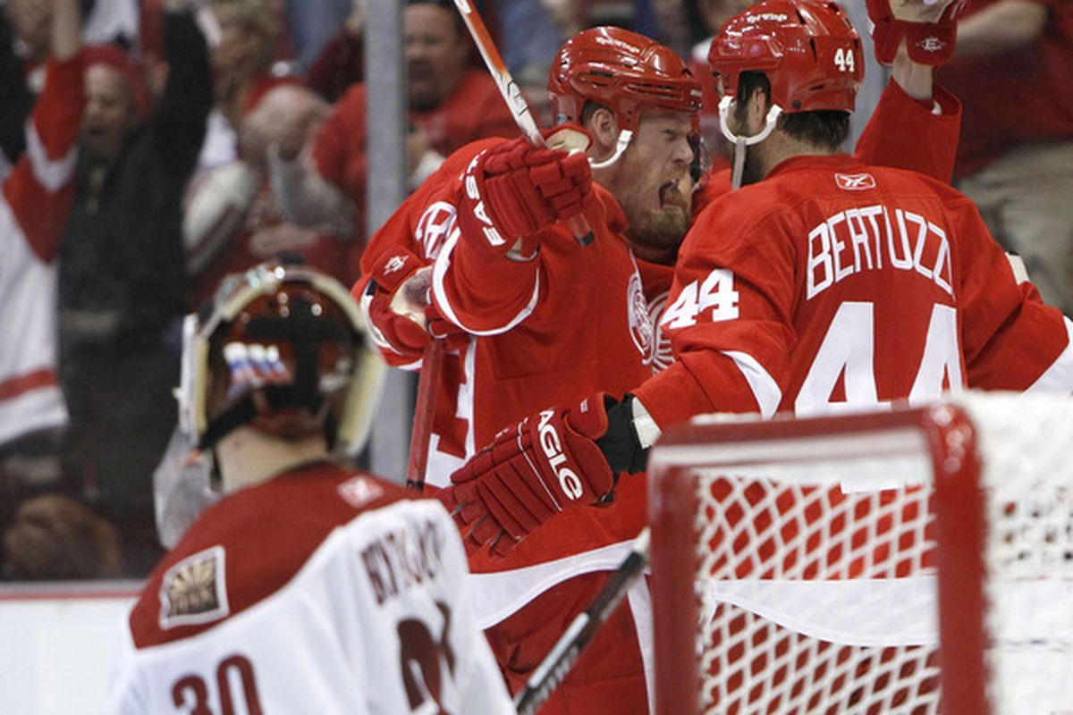 Johan Franzen and Todd Bertuzzi celebrate while Ilya Bryzgalov looks on Sunday. The Wings need some more of this to keep their hopes alive tonight.