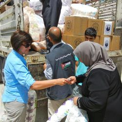 LDS humanitarian missionary Sister Karyn Anderson oversees distribution of hygiene supplies to to transitional refugee camps in Jordan.