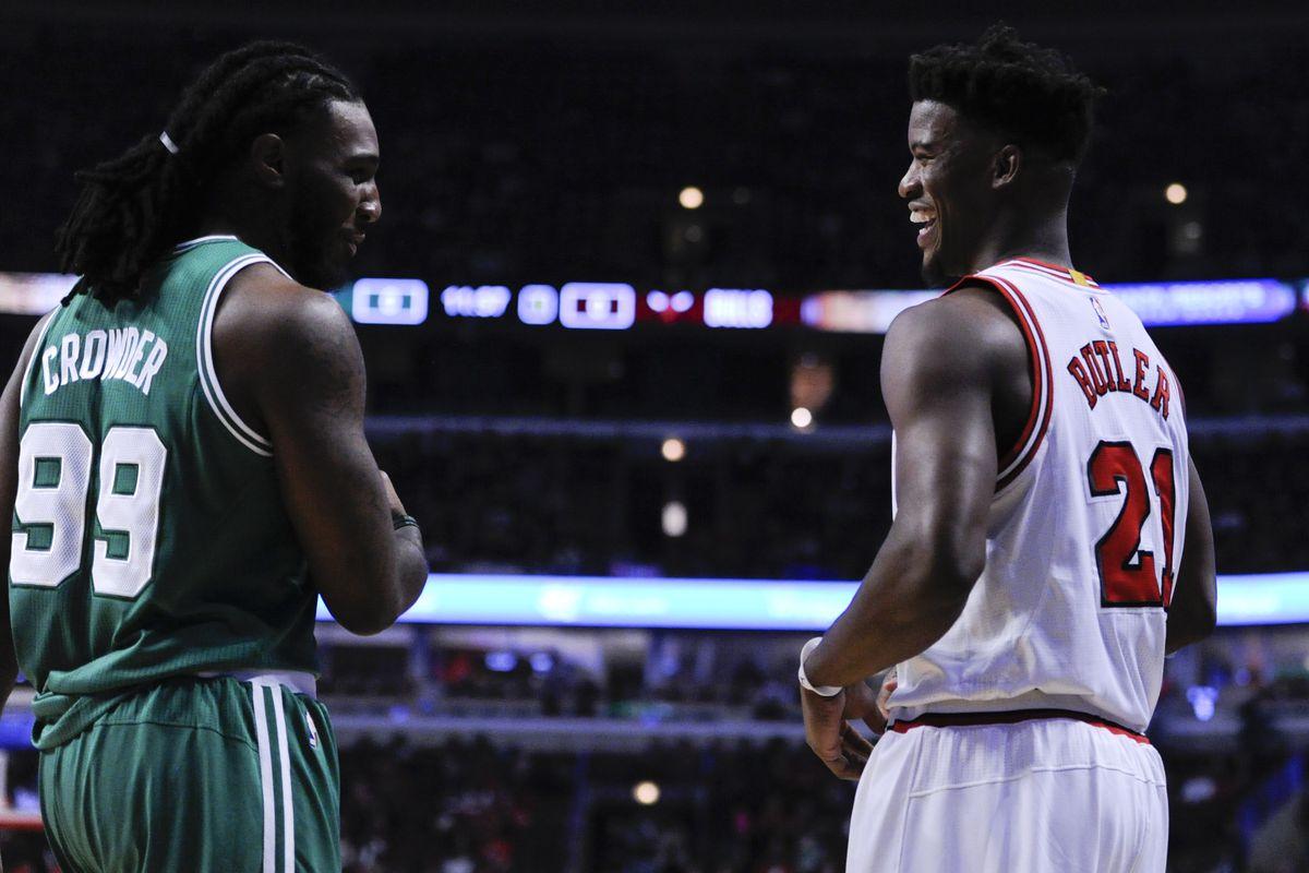 Chicago Bulls' Jimmy Butler, right, talks with Boston Celtics' Jae Crowder (99) before a season opening NBA basketball game against the Boston Celtics Thursday, Oct. 27, 2016, in Chicago. (AP Photo/Matt Marton)