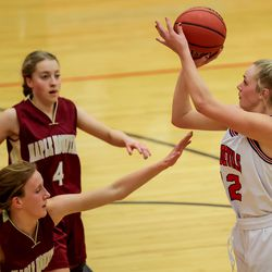 Springville's Lauryn Deede shoots over Maple Mountain's Sheridan Liggett in a girls basketball game in Springville on Tuesday, Jan. 26, 2021.