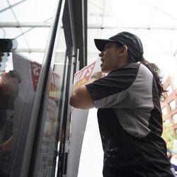 Adriana Alvarez holds a list of demands outside the McDonald's headquarters. | Colin Boyle/Sun-Times