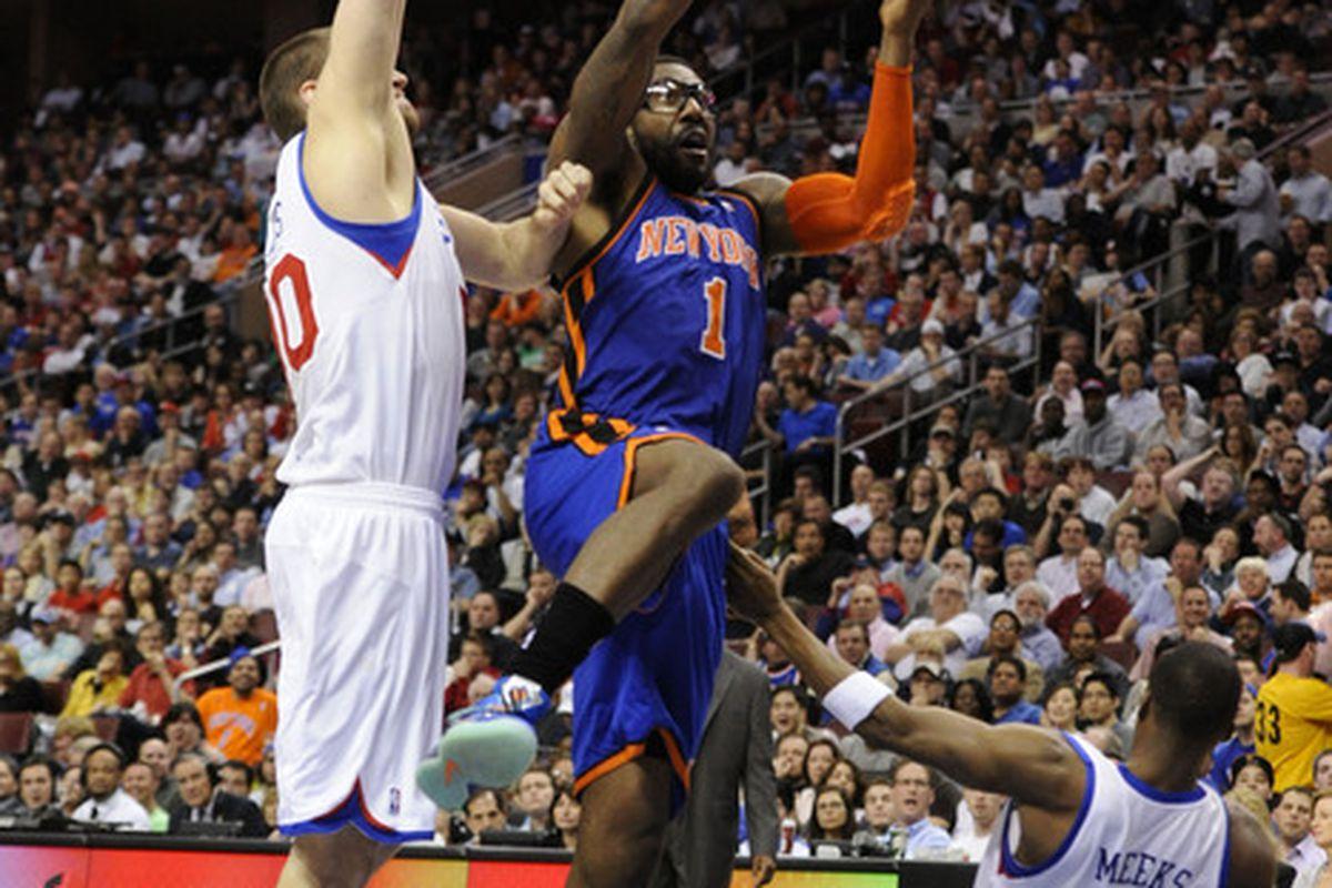 Mar 21, 2012; Philadelphia, PA, USA; New York Knicks forward Amar'e Stoudemire (1) shoots as Philadelphia 76ers center Spencer Hawes (00) defends  during the second quarter at the Wells Fargo Center. Mandatory Credit: Howard Smith-US PRESSWIRE