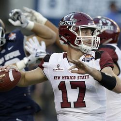 New Mexico State quarterback Tyler Rogers (17) throws downfield against Utah State in the first half of the Arizona Bowl NCAA college football game Friday, Dec. 29, 2017, in Tucson, Ariz. (AP Photo/Rick Scuteri)