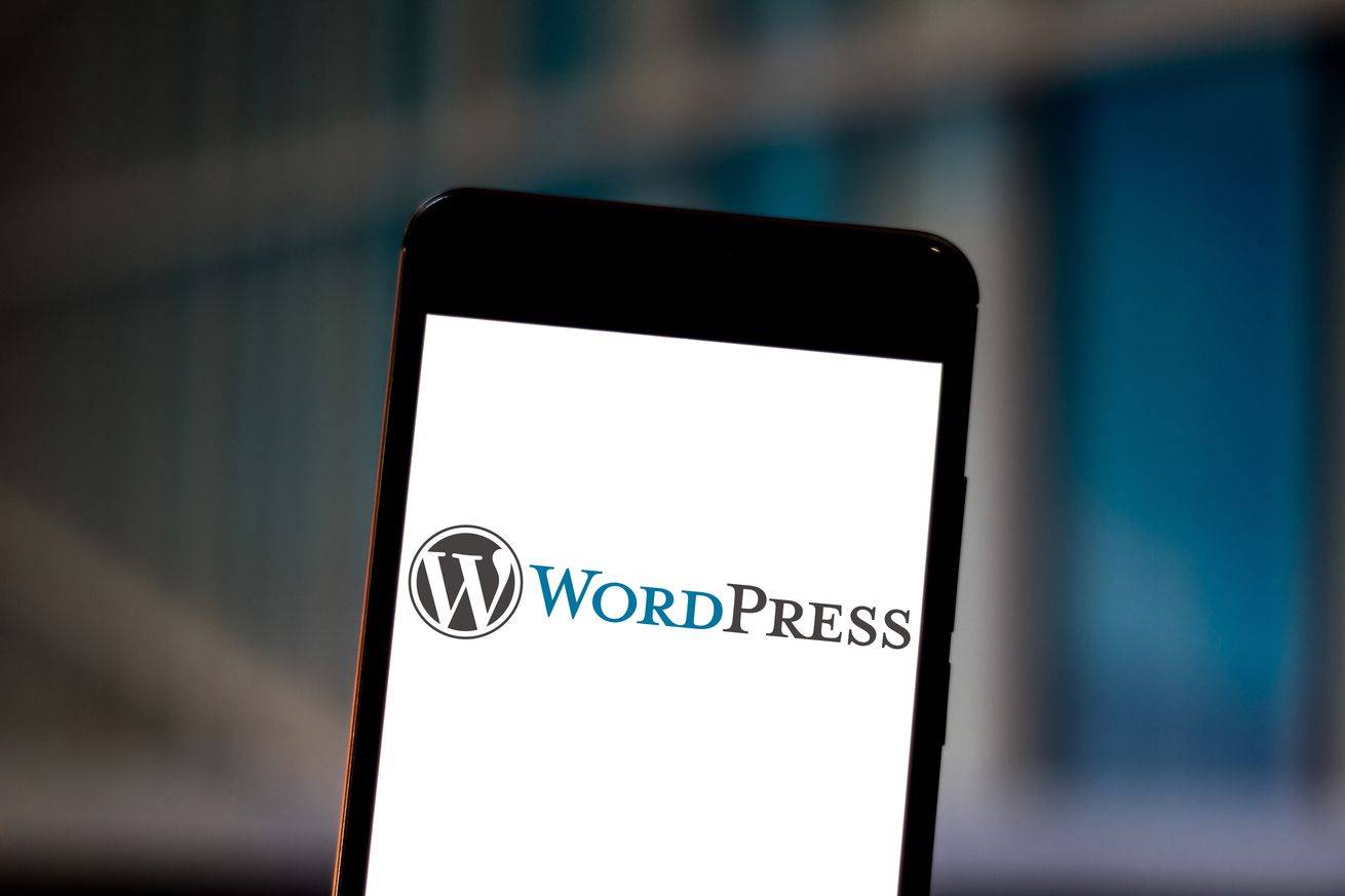 In this photo illustration the WordPress logo is displayed...