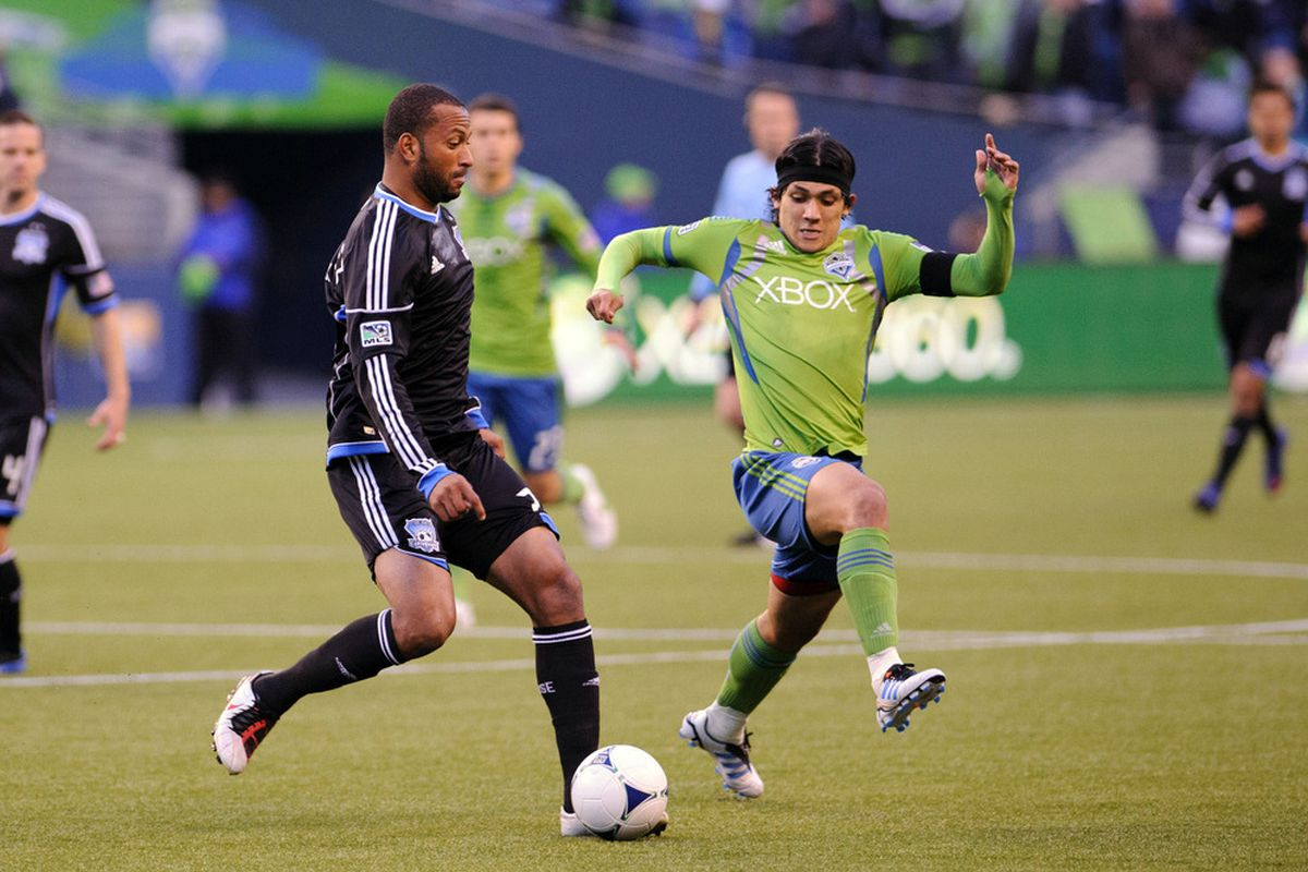 Mar 31, 2012; Seattle, WA, USA; Seattle Sounders FC forward Fredy Montero (17) lunges to block a pass by San Jose Earthquakes midfielder Marvin Chavez (81) during the 1st half at CentryLink field. Mandatory Credit: Steven Bisig-US PRESSWIRE