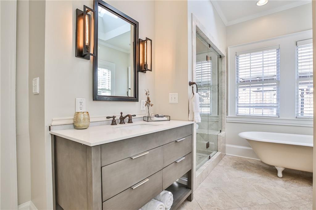 A white bathroom and standalone tub.
