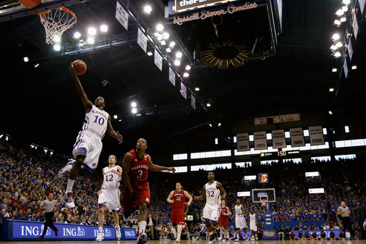 LAWRENCE KS - JANUARY 15:  Tyshawn Taylor #10 of the Kansas Jayhawks scores on a fast break during the game against the Nebraska Cornhuskers on January 15 2011 at Allen Fieldhouse in Lawrence Kansas.  (Photo by Jamie Squire/Getty Images)