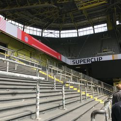 The away section of the <em>Nordtribüne</em>, where a majority of the Bayern Munich fans took in the match. One of the corner sections, which do not precisely line up with the original stands is also visible. August 2, 2019.