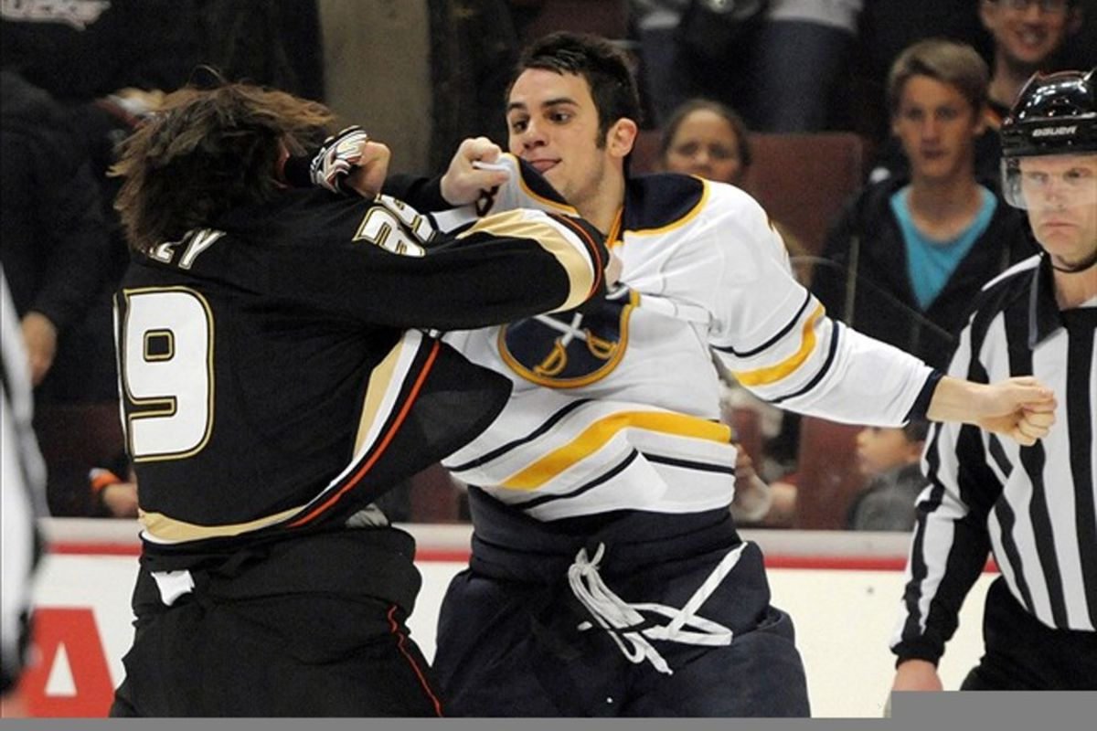 Feb 29, 2012; Anaheim, CA, USA; Anaheim Ducks left wing Matt Beleskey (39), left, and Buffalo Sabres right wing Corey Tropp (78) fight in the second period at the Honda Center. Mandatory Credit: Kirby Lee/Image of Sport-US PRESSWIRE