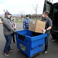 Mike Moon, associate director of UServeUtah, and Ladawn Stoddard, division director of UServeUtah, accept a donation of N95 masks from Zagg's Jeff DuBois, public relations director, and Bryan Kush, human resources manager, in Salt Lake City on Tuesday, April 14, 2020. Zagg is donating 10,000 of the masks to hospitals, medical professionals and high-risk individuals to help combat the spread of COVID-19 in the communities in which the company operates.