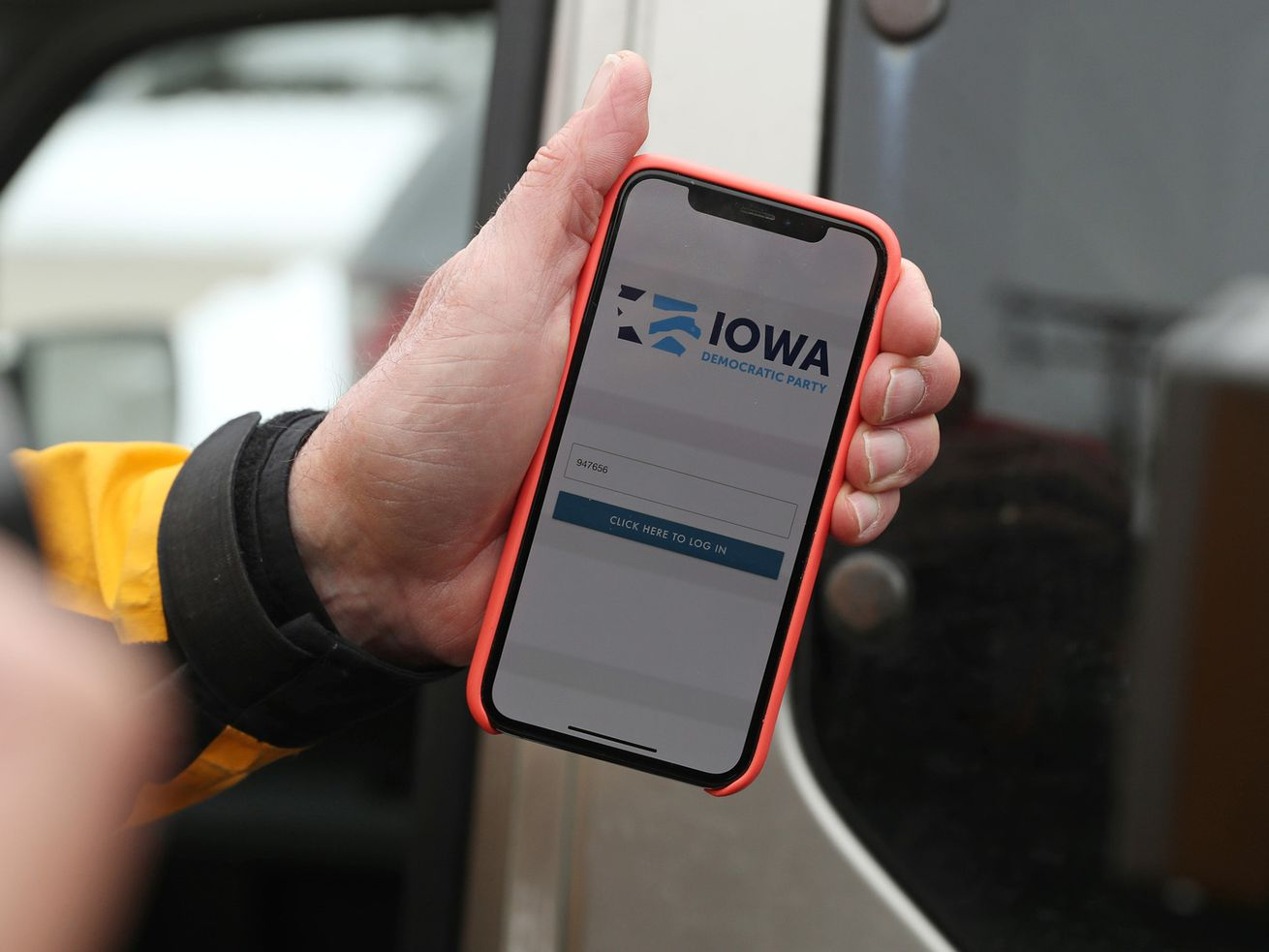 A phone where the screen reads: Iowa Democratic Party.