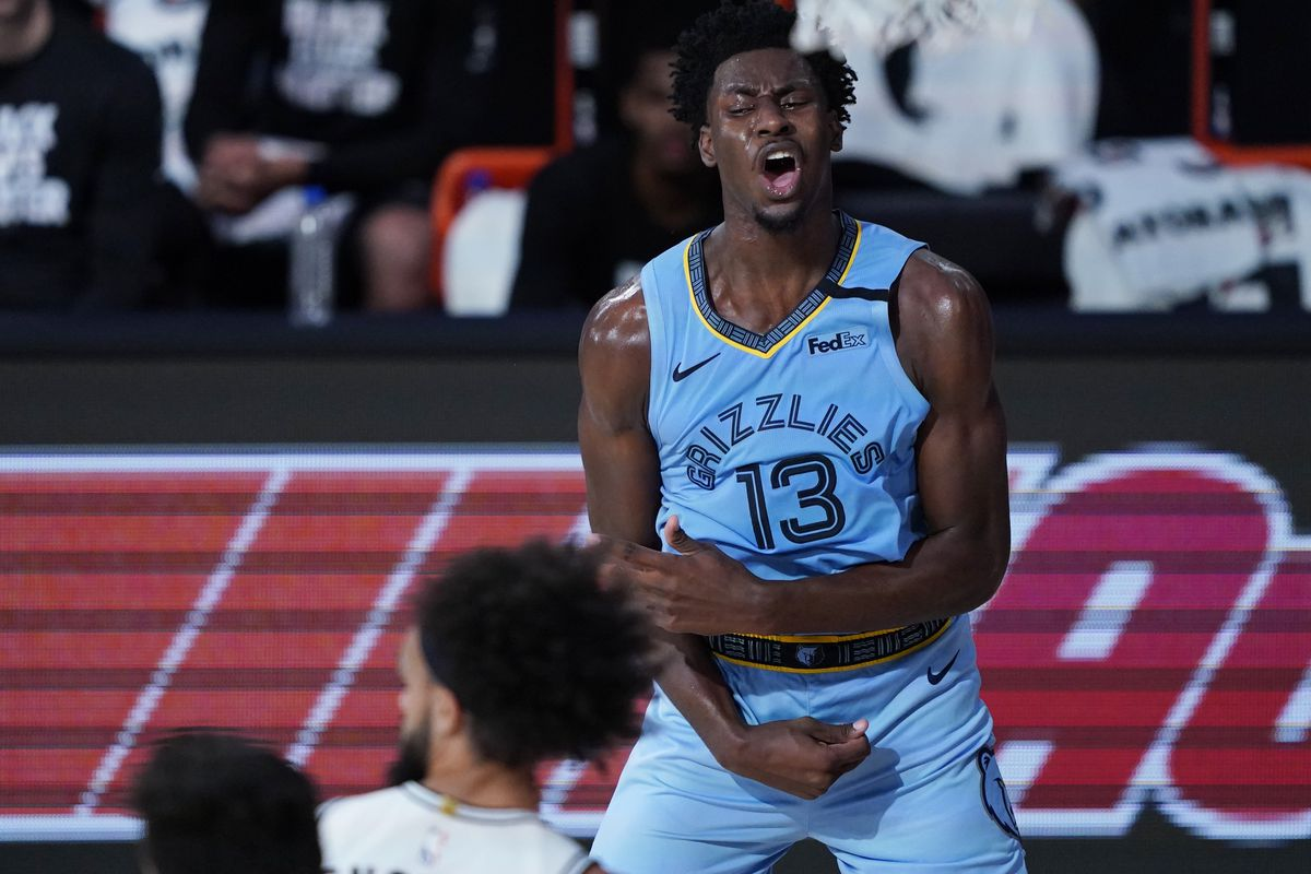 Memphis Grizzlies' Jaren Jackson Jr. reacts after a play against the San Antonio Spurs during the second half of an NBA basketball game Sunday, Aug. 2, 2020, in Lake Buena Vista, Fla.