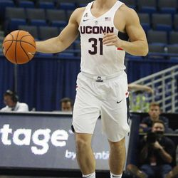 UConn's Michael Noyes (31) brings the ball up the court at the end of the game.