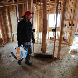 Brennan Elton, of Big Sky Automation, installs low-voltage wiring in a home in Daybreak on Friday, Feb. 3, 2017. According to the 2017 Salt Lake Housing Forecast report released on Friday by the Salt Lake Board of Realtors, the Salt Lake County real estate market in 2016 had its best year in a decade.