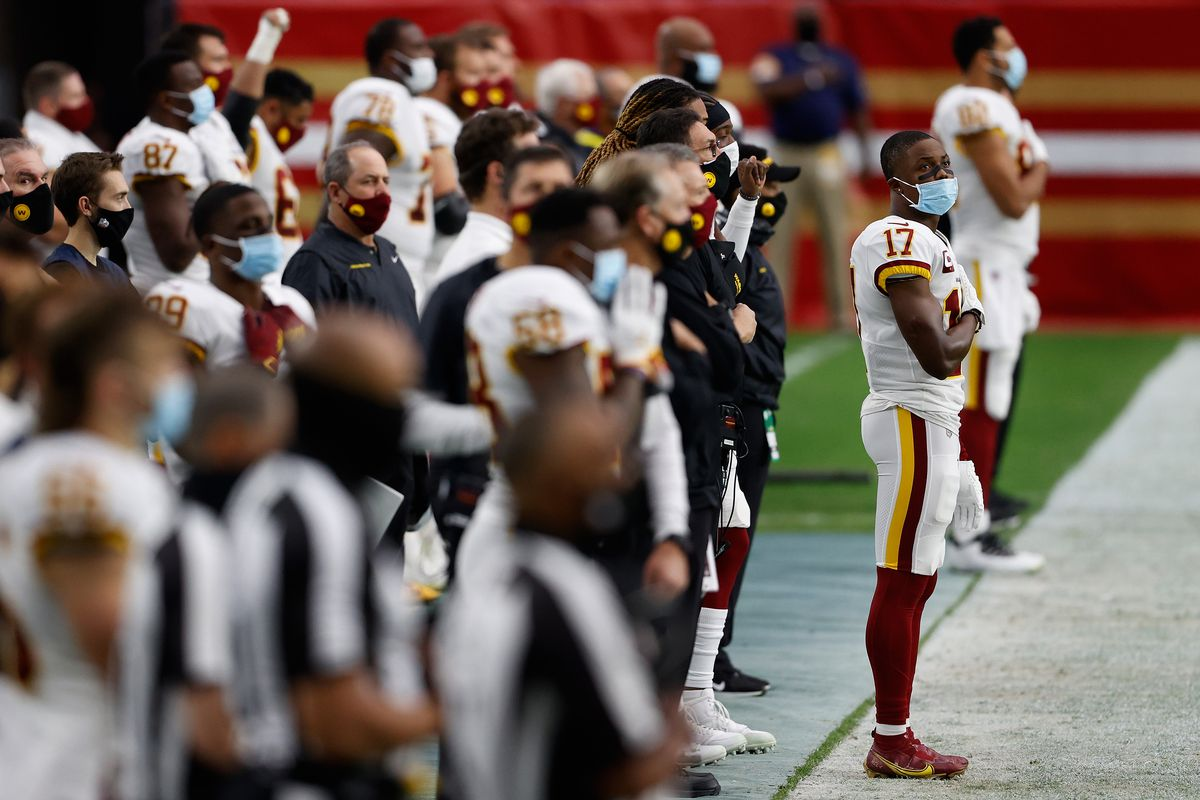 Wide receiver Terry McLaurin #17 of the Washington Football Team stands attended with teammates for the national anthem before the NFL game against the San Francisco 49ers at State Farm Stadium on December 13, 2020 in Glendale, Arizona. The Washington Football Team defeated the 49ers 23-15.