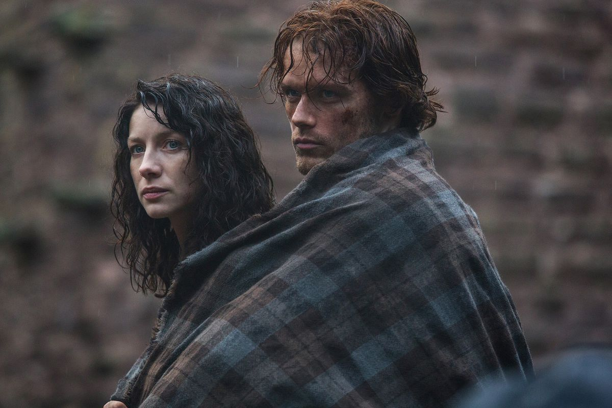 Claire (Caitriona Balfe) and Jamie (Sam Heughan) ride together in Outlander.