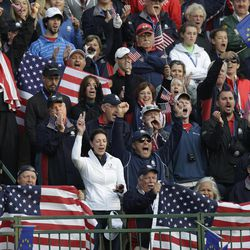Fans cheer on the first tee during a foursomes match at the Ryder Cup PGA golf tournament Saturday, Sept. 29, 2012, at the Medinah Country Club in Medinah, Ill.