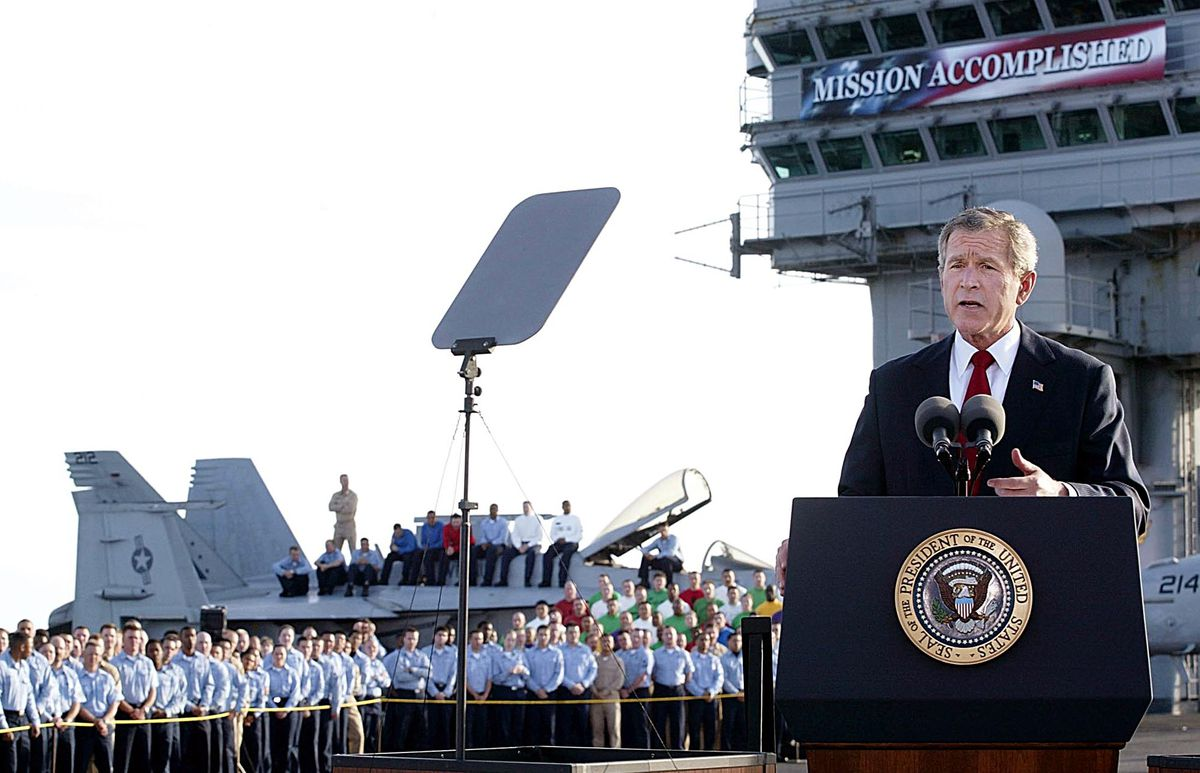 Bush on the Lincoln's deck with the banner aloft behind him.