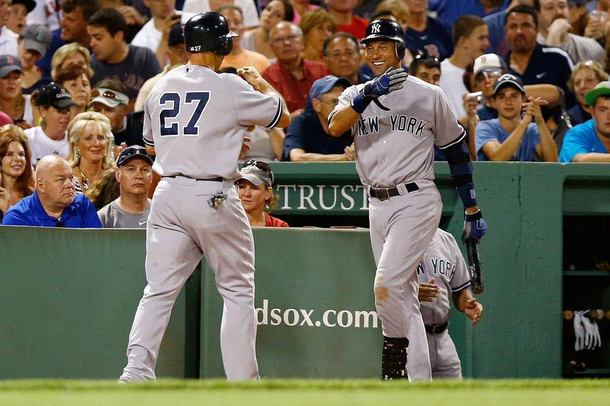 Derek Jeter and Raul Ibanez: in the Mr. October of their professional lives.  (Photo by Jared Wickerham/Getty Images)
